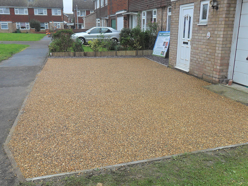 Completed driveway with embeded peashingle in bitumen