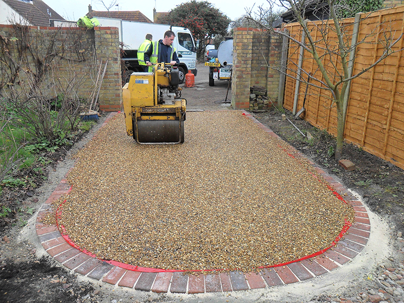 Hot bitumen tar and pea shingle surface for courtyard area.