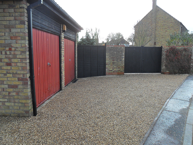 Finished car park area with new gated entrance for courtyard.