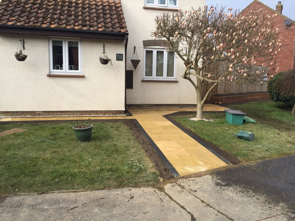 Completed Job using paving slabs with charcoal brick paved edge