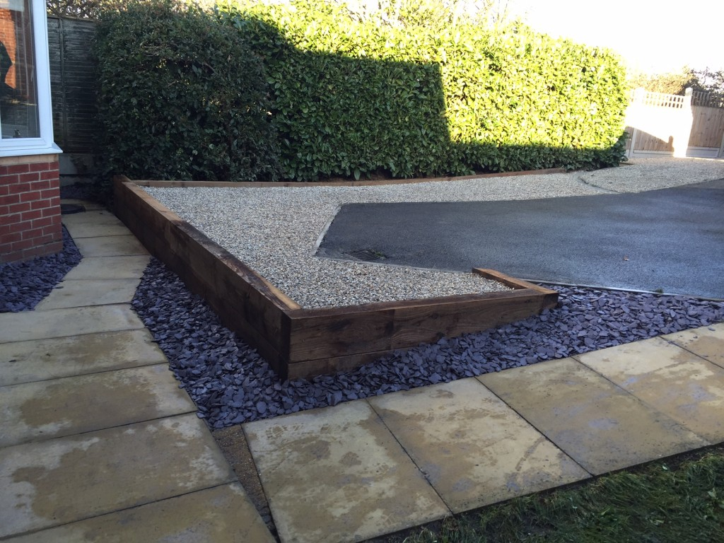 Completed job, landscaping and driveway with retained railway sleeper edging