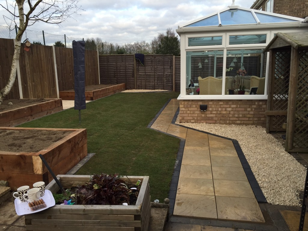 Complete Landscaping Job, with retained flower beds using sleepers, new lawn and new paved pathway.
