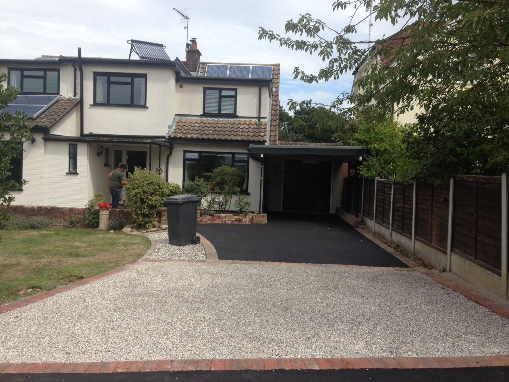 Completed Job - Hot rolled tarmac at rear with hot bitumin embeded with pea shingle at front